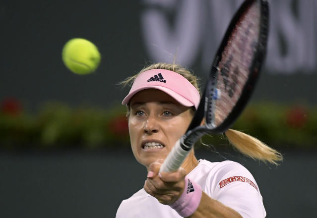 Angelique Kerber, of Germany, hits a forehand to Belinda Bencic, of Switzerland, at the BNP Paribas Open tennis tournament Friday, March 15, 2019, in Indian Wells, Calif. (AP Photo/Mark J. Terrill)