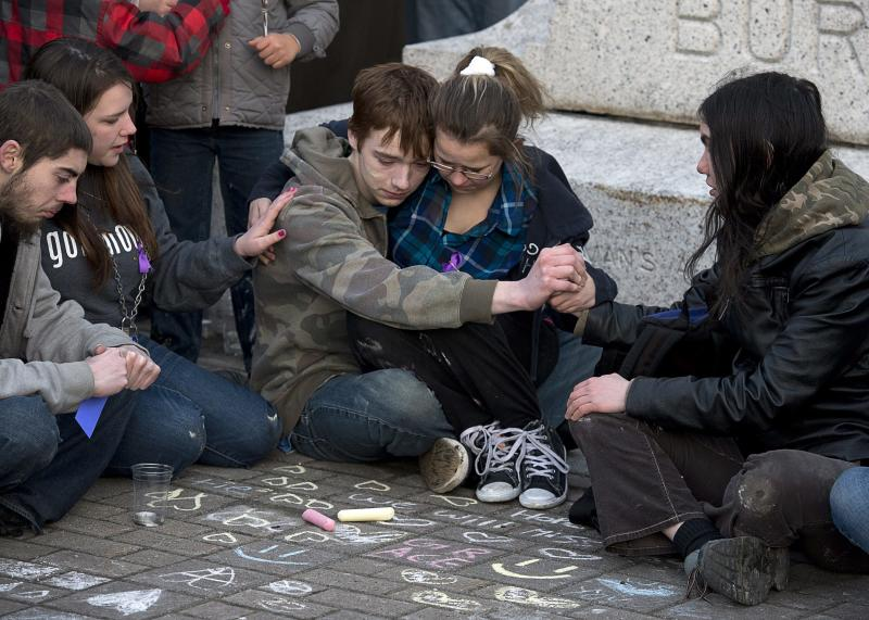 Several hundred people attend a community vigil to remember Rehtaeh Parsons at Victoria Park in Halifax, Nova Scotia, on Thursday, April 11, 2013. The girl's family says she ended her own life last week following months of bullying after she was allegedly sexually assaulted by four boys and a photo of the incident was distributed. (AP Photo/The Canadian Press, Andrew Vaughan)