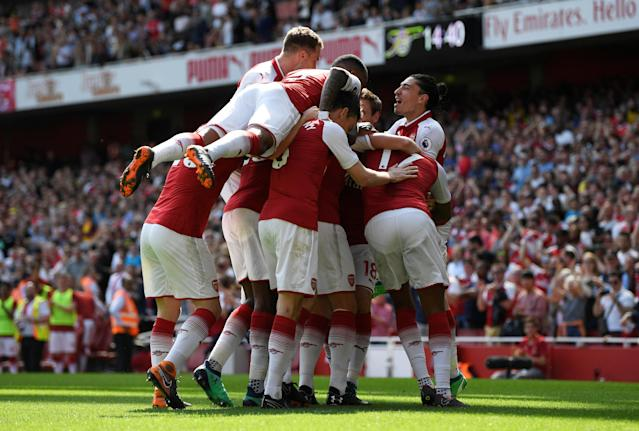 """Soccer Football - Premier League - Arsenal v West Ham United - Emirates Stadium, London, Britain - April 22, 2018 Arsenal's Nacho Monreal (hidden) celebrates with team mates after scoring their first goal Action Images via Reuters/Tony O'Brien EDITORIAL USE ONLY. No use with unauthorized audio, video, data, fixture lists, club/league logos or """"live"""" services. Online in-match use limited to 75 images, no video emulation. No use in betting, games or single club/league/player publications. Please contact your account representative for further details."""