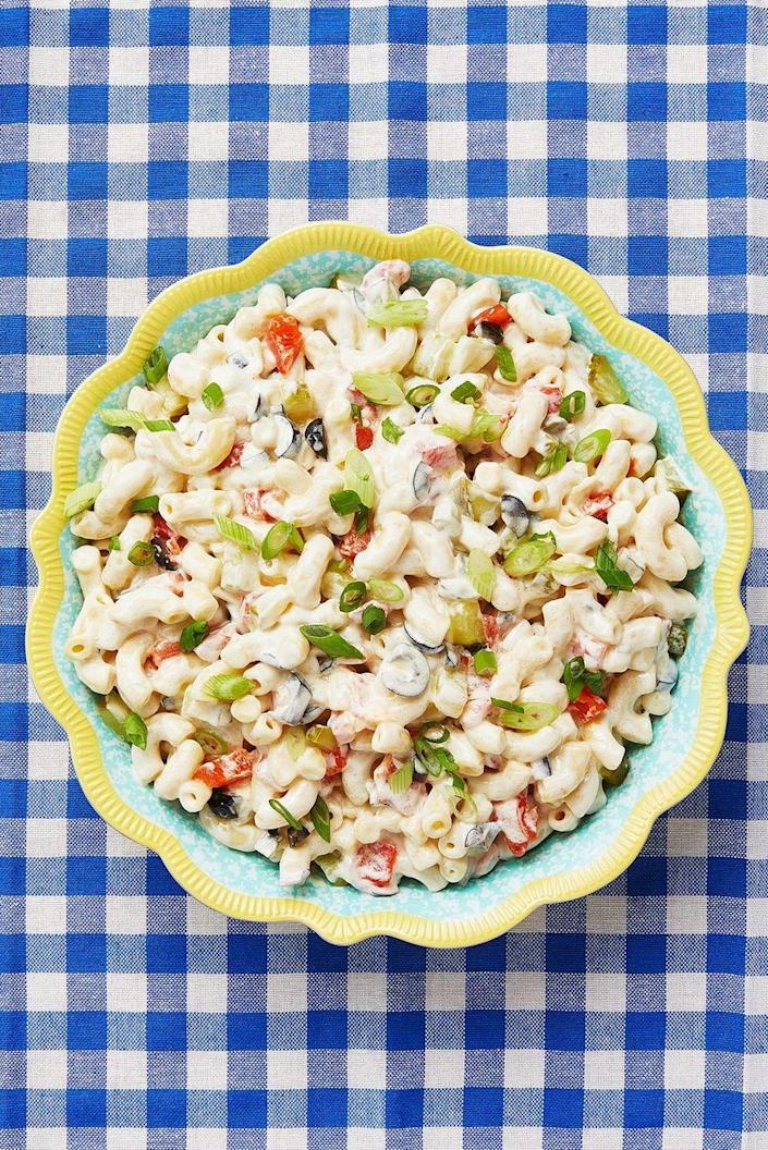 """<p>Even the pickiest eaters will love this classic macaroni salad. It's sweet, but tangy and creamy, and also light. The best of all worlds. </p><p><a href=""""https://www.thepioneerwoman.com/food-cooking/recipes/a10675/the-best-macaroni-salad-ever/"""" rel=""""nofollow noopener"""" target=""""_blank"""" data-ylk=""""slk:Get Ree's recipe."""" class=""""link rapid-noclick-resp""""><strong>Get Ree's recipe. </strong></a></p><p><a class=""""link rapid-noclick-resp"""" href=""""https://go.redirectingat.com?id=74968X1596630&url=https%3A%2F%2Fwww.walmart.com%2Fsearch%2F%3Fquery%3Dpioneer%2Bwoman%2Bserving%2Bbowls&sref=https%3A%2F%2Fwww.thepioneerwoman.com%2Ffood-cooking%2Fmeals-menus%2Fg36353420%2Ffourth-of-july-side-dishes%2F"""" rel=""""nofollow noopener"""" target=""""_blank"""" data-ylk=""""slk:SHOP SERVING BOWLS"""">SHOP SERVING BOWLS</a></p>"""