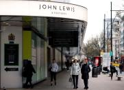 People walk past a temporarily closed John Lewis department store on Oxford Street in London