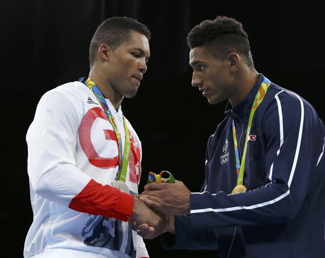 2016 Rio Olympics - Boxing - Victory Ceremony - Men's Super Heavy (+91kg) Victory Ceremony - Riocentro - Pavilion 6 - Rio de Janeiro, Brazil - 21/08/2016. Silver medallist Joseph Joyce (GBR) of Britain shakes hands with gold medallist Tony Yoka (FRA) of France. REUTERS/Peter Cziborra FOR EDITORIAL USE ONLY. NOT FOR SALE FOR MARKETING OR ADVERTISING CAMPAIGNS.