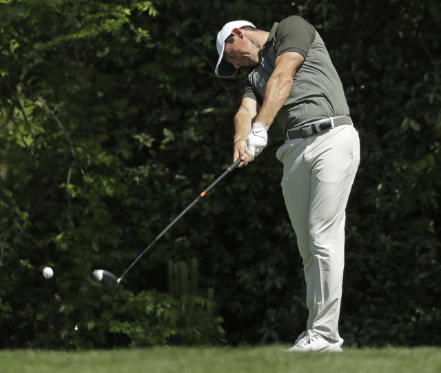 Rory McIlroy, of Northern Ireland, hits his tee shot on the seventh hole during the pro-am of the Wells Fargo Championship golf tournament at Quail Hollow Club in Charlotte, N.C., Wednesday, May 2, 2018. McIlroy looks to bounce back after a disappointing performance at the Masters on one of his favorite courses, Quail Hollow Club. (AP Photo/Chuck Burton)