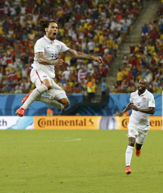 Jermaine Jones of the U.S. celebrates with DaMarcus Beasley of the U.S. after scoring a goal during the 2014 World Cup G soccer match between Portugal and the U.S. at the Amazonia arena in Manaus June 22, 2014. REUTERS/Siphiwe Sibeko (BRAZIL - Tags: TPX IMAGES OF THE DAY SOCCER SPORT WORLD CUP)