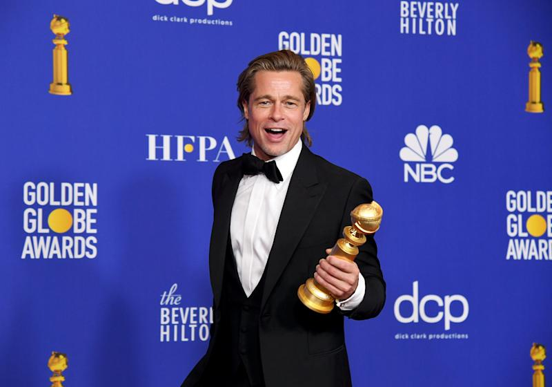 Brad Pitt with his Golden Globe after his win