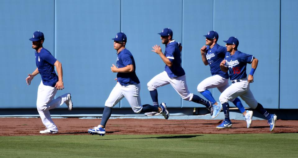 LOS ANGELES, CA - JULY 03:  Los Angeles Dodgers center fielder Cody Bellinger, left, and teammates runs in the outfield during the Los Angeles Dodgers first summer camp workout in preparation for the 2020 season due to the Coronavirus Pandemic in Los Angeles on Friday, July 3, 2020. (Photo by Keith Birmingham/MediaNews Group/Pasadena Star-News via Getty Images)
