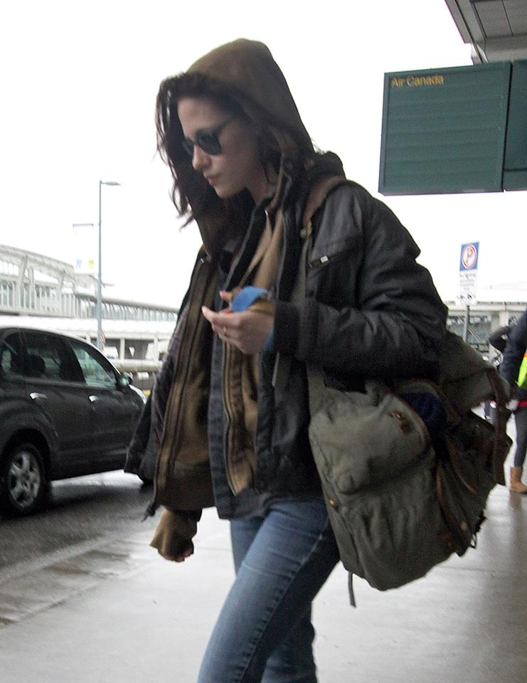 "Kristen Stewart arrives back in Vancouver, Canada to resume filming ""Twilight Breaking Dawn"". 