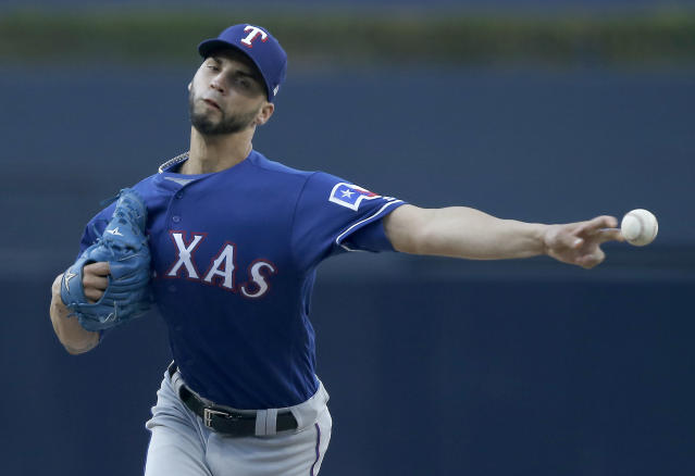 Rangers have traded reliever Alex Claudio to the Brewers. (AP)