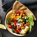 """<p>The bright, fresh flavors of the Mediterranean come alive in these easy vegetarian pitas. Give yourself enough time to make the roasted vegetables called for in the recipe--or make them a day or two in advance for a healthy meal that takes less than 30 minutes to prepare. These pitas would also work well with whatever leftover cooked veggies you have on hand. No need to warm the roasted veggies up; this recipe tastes great chilled or at room temperature. <a href=""""https://www.eatingwell.com/recipe/273586/piled-high-greek-vegetable-pitas/"""" rel=""""nofollow noopener"""" target=""""_blank"""" data-ylk=""""slk:View Recipe"""" class=""""link rapid-noclick-resp"""">View Recipe</a></p>"""