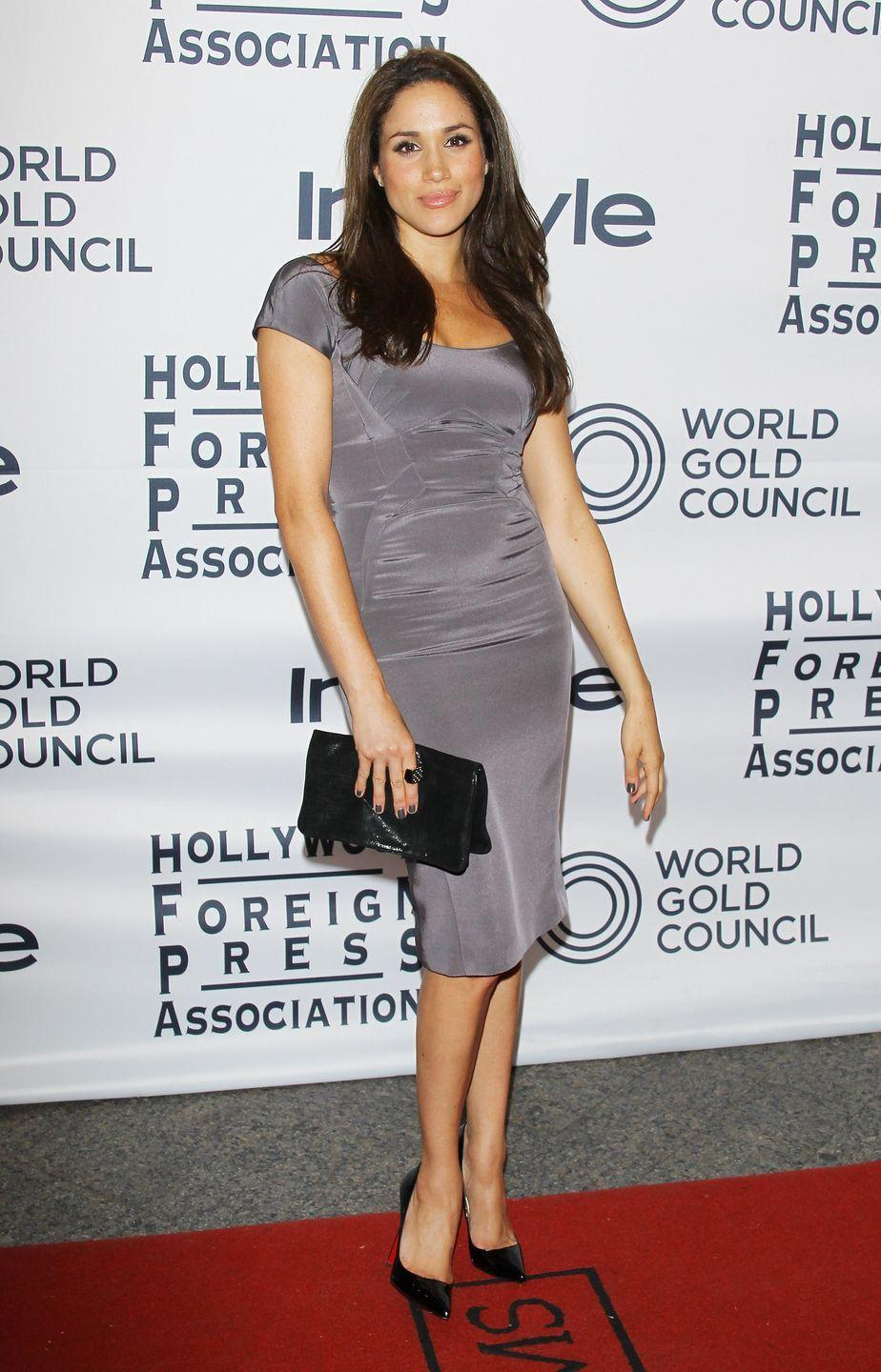 <p>Markle wore a subdued gray shift dress to the Toronto International Film Festival. </p>