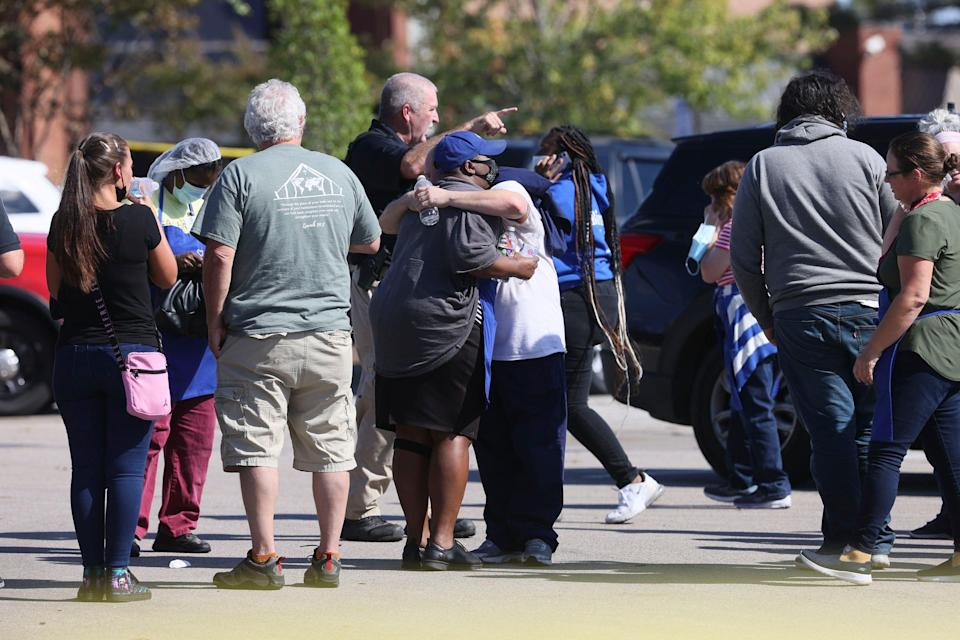 People embrace as police respond to the scene of a shooting at a Kroger's grocery store in Collierville, Tennessee (AP)
