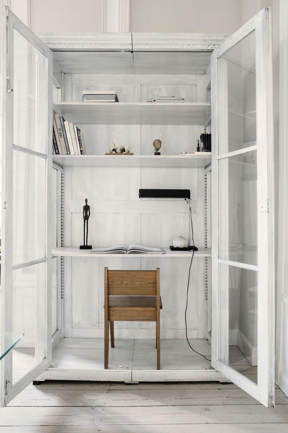 """<p>No extra room for a dedicated study, but still want to be able to lock the door on work at the end of the day? Interior designer and collector Oliver Gustav's answer is an upcycled Danish cabinet. Found in a zoological museum, it's been transformed – by removing a few shelves to make room for a chair – into a dedicated desk. <a href=""""https://olivergustav.com/"""" rel=""""nofollow noopener"""" target=""""_blank"""" data-ylk=""""slk:olivergustav.com"""" class=""""link rapid-noclick-resp"""">olivergustav.com</a></p>"""