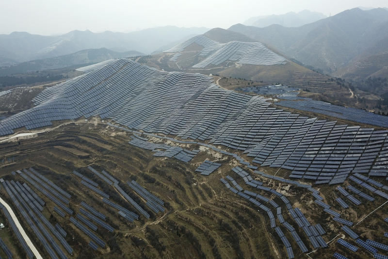 In this Nov. 27, 2019, file photo, a solar panel installation is seen in Ruicheng County in central China's Shanxi Province. As world leaders gather in Madrid to discuss how to slow the warming of the planet, a spotlight is falling on China, the top emitter of greenhouse gases. China burns about half the coal used globally each year. Yet it's also the leading market for solar panels, wind turbines and electric vehicles. (AP Photo/Sam McNeil, File)