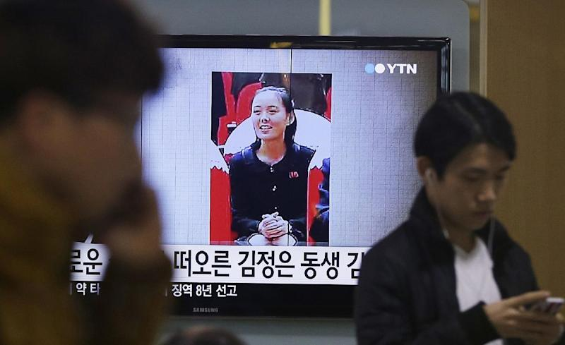"FILE - In this Nov. 27, 2014 file photo, a TV news program shows a photo of Kim Yo Jong, North Korean leader Kim Jong Un's younger sister, at Seoul Railway Station in Seoul, South Korea. The alleged murder of North Korean leader Kim Jong Un's estranged half-brother could be the best cloak-and-dagger thriller North Koreans will never get to hear. It is simpler to keep the line of succession and power as clear and direct as possible. Kim Yo Jong is a powerful member of the ruling elite. The letters read ""Kim Jong Un's sister."" (AP Photo/Ahn Young-joon, File)"