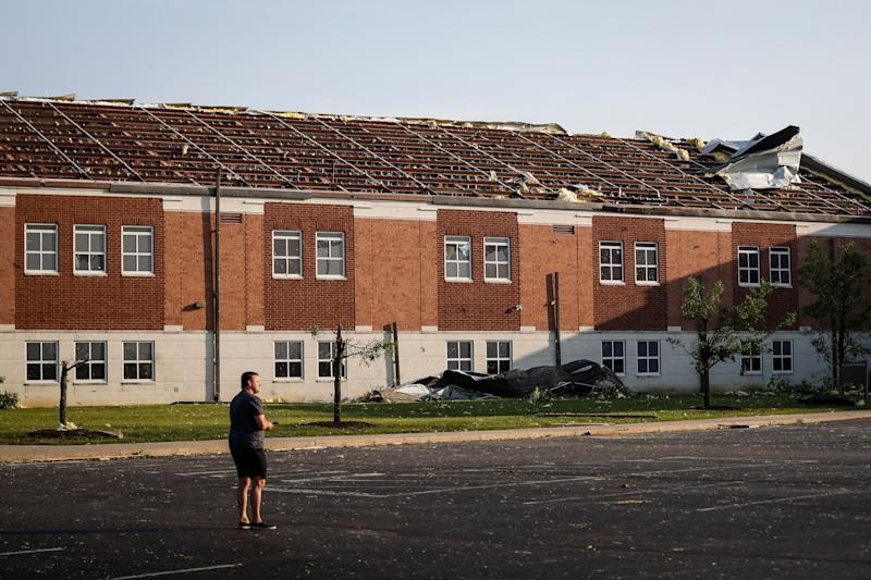 A section of roof remains torn from Brookville High School after a tornado hit the area the previous evening, Tuesday, May 28, 2019, in Brookville, Ohio. (Photo: John Minchillo/AP)