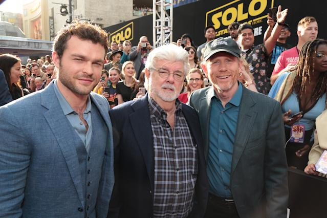 Alden Ehrenreich, George Lucas, and Ron Howard on the <i>Solo</i> red carpet. (Photo: Lucasfilm/Disney)