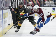 Vegas Golden Knights center Jonathan Marchessault (81) vies for the puck with with Colorado Avalanche defenseman Conor Timmins (22) during the second period of an NHL hockey game Monday, May 10, 2021, in Las Vegas. (AP Photo/John Locher)