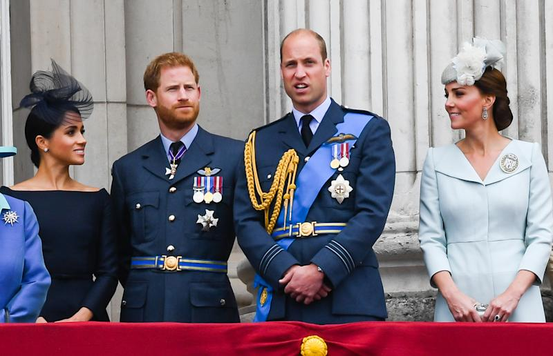 Meghan and Kate talk while Harry and William watch Trooping the Colour