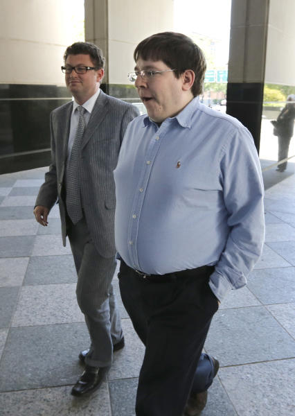 Matthew Keys, right, who faces federal charges that he allegedly conspired with hacker to deface the website of the Los Angeles Times, walks to the federal courthouse for his arraignment with his attorney Jason Leiderman, in Sacramento, Calif.,Tuesday, April 23, 2013. Keys pleaded not guilty to charged with giving the hacking group, Anonymous, the log-in credentials to the computer system of the Tribune Co., which owns the Los Angeles Times, Chicago Tribune, Baltimore Sun and other media properties. (AP Photo/Rich Pedroncelli)