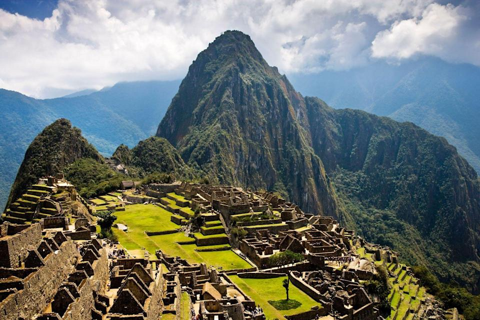 """<p><strong>Machu Picchu, Peru</strong></p><p>The 15th century Incan city of Machu Picchu is one of the most iconic locales in the world, and it's not as difficult to reach as you might assume. If you're really ambitious, you can travel by foot along the Inca Trail. But, if that's not your style, take a quick flight from Lima to Cusco and hop a train to the small town of Aguas Calientes, located at the base of Machu Picchu. From there, you either hike or take a short bus ride to the ruins. All entrance tickets to the ancient city must be booked in advance, because the government limits the number of people who can visit each day, so be sure to plan ahead.</p><span class=""""copyright"""">Photo: Anna Stowe Travel / Alamy. </span>"""