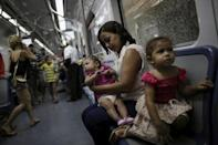 """Luana Vieira, four months old, who was born with microcephaly, is held by her mother Rosana Vieira Alves as they ride the subway after a doctor's appointment in Recife, Brazil, February 3, 2016. REUTERS/Ueslei Marcelino/File Photo SEARCH """"ZIKA"""" FOR THIS STORY. SEARCH """"WIDER IMAGE"""" FOR ALL STORIES."""