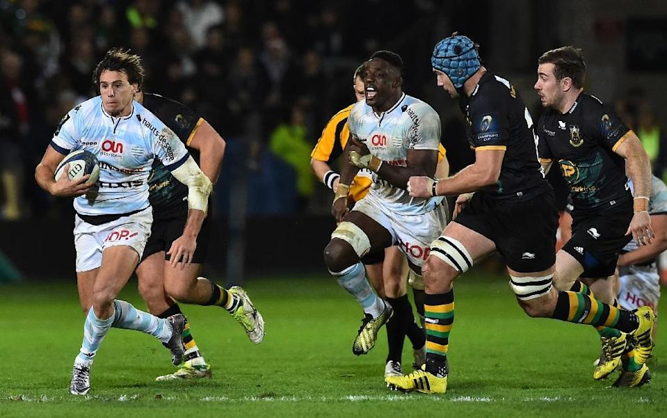 Racing 92 wing Juan Imhoff (L) makes a break during the European Rugby Champions Cup match against Northampton in Northampton on December 18, 2015 (AFP Photo/Ben Stansall)