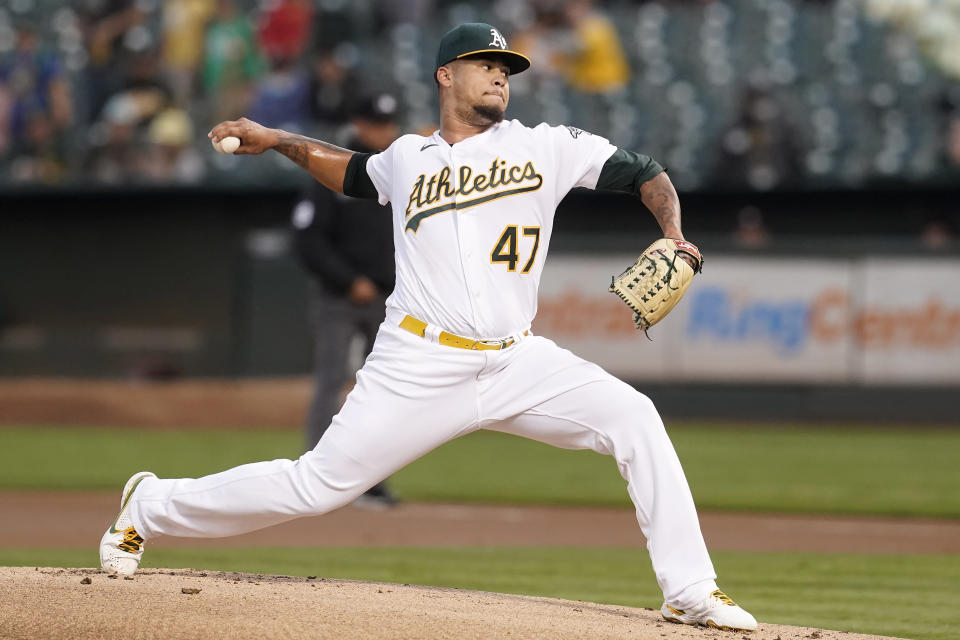 Oakland Athletics' Frankie Montas pitches against the Houston Astros during the first inning of a baseball game in Oakland, Calif., Friday, Sept. 24, 2021. (AP Photo/Jeff Chiu)
