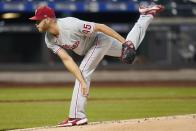 Philadelphia Phillies' Zack Wheeler (45) delivers a pitch during the first inning of a baseball game against the New York Mets Wednesday, April 14, 2021, in New York. (AP Photo/Frank Franklin II)