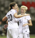 Abby Wambach #20 and Mega Rapinoe #15 of the U.S. celebrate a goal against Guatemala during the 2012 CONCACAF Women's Olympic Qualifying Tournament at BC Place on Jan. 22, 2012, in Vancouver, Canada. (Photo by Jeff Vinnick/Getty Images)