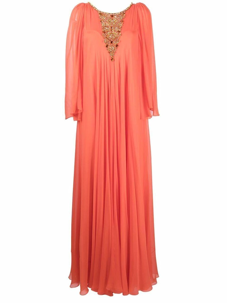 """<p><strong>Jenny Packham</strong></p><p>farfetch.com</p><p><strong>$5396.00</strong></p><p><a href=""""https://go.redirectingat.com?id=74968X1596630&url=https%3A%2F%2Fwww.farfetch.com%2Fshopping%2Fwomen%2Fjenny-packham-crystal-embellished-pleated-gown-item-16843031.aspx&sref=https%3A%2F%2Fwww.harpersbazaar.com%2Fwedding%2Fbridal-fashion%2Fg36750122%2Fbest-mother-of-the-groom-dresses%2F"""" rel=""""nofollow noopener"""" target=""""_blank"""" data-ylk=""""slk:SHOP NOW"""" class=""""link rapid-noclick-resp"""">SHOP NOW</a></p><p>Black tie affairs (traditionally) mean floor length looks with luxe accessories. For the mother of the groom, opt for a gown that has built-in accessories, like embellishments at the neckline. Then, just add dainty earrings and effortless hair and makeup.</p>"""