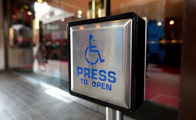 A disabled entrance door button (Andrew Matthews/PA)