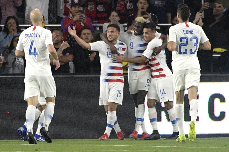 United States forward Gyasi Zardes (9) is congratulated by teammates after scoring a goal during the second half of an international friendly soccer match against Ecuador, Thursday, March 21, 2019, in Orlando, Fla. (AP Photo/Phelan M. Ebenhack)