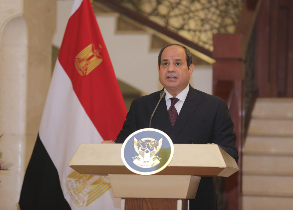 Egyptian President Abdel Fattah al-Sisi holds a news conference with the Chairman of the Sovereignty Council of Sudan Gen. Abdel Fattah Abdelrahman al-Burhan at the Presidential Palace in Khartoum, Sudan, Saturday, March. 6, 2021. Egypt's presidency says President Abdel Fattah el-Sissi trip was to address an array of issues, including economic and military ties and the two nations' dispute with Ethiopia over a massive dam Addis Ababa is building on the Blue Nile. The visit comes amid a rapprochement between the two governments. (Presidency of Sudan via AP)