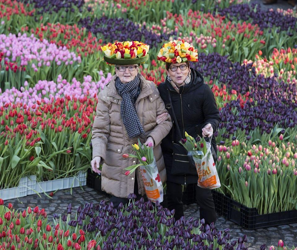 """<p>People attend Dutch National Tulip Day in front of the Royal Palace</p><p><a class=""""link rapid-noclick-resp"""" href=""""https://www.primaholidays.co.uk/tours/netherlands-holland-tulips-cruise-adam-frost"""" rel=""""nofollow noopener"""" target=""""_blank"""" data-ylk=""""slk:FIND OUT ABOUT PRIMA'S AMSTERDAM CRUISE"""">FIND OUT ABOUT PRIMA'S AMSTERDAM CRUISE</a></p>"""