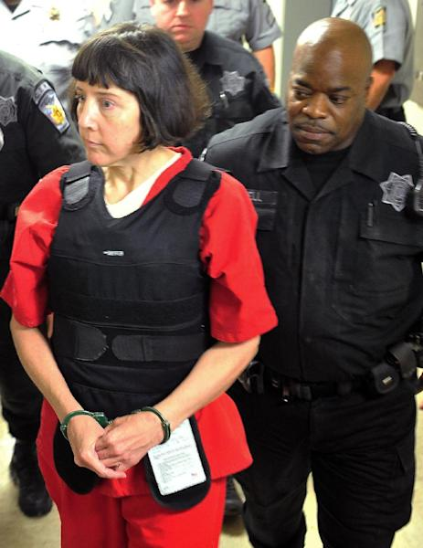 FILE - In this Sept. 11, 2012, file photo, Amy Bishop, accused of killing three and injuring three others in a Feb. 12, 2010 shooting at the University of Alabama in Huntsville, walks into a courtroom at the Madison County Courthouse in Huntsville, Ala. Bishop pleaded guilty to capital murder charges in an agreement that will send to her prison for the rest of her life and make her ineligible for the death penalty. A judge scheduled jury selection for Monday, Sept. 24, 2012, as a trial is still required under Alabama law because Bishop admitted to a capital charge of murder. (AP Photo/The Huntsville Times, Eric Schultz, File)