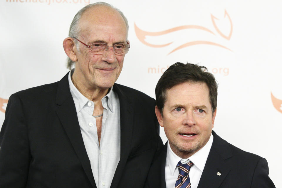 Christopher Lloyd, left, and Michael J. Fox, right, attend the Michael J. Fox Foundation 2018 benefit gala at the New York Hilton Midtown on Saturday, Nov. 10, 2018, in New York. (Photo by Andy Kropa/Invision/AP)
