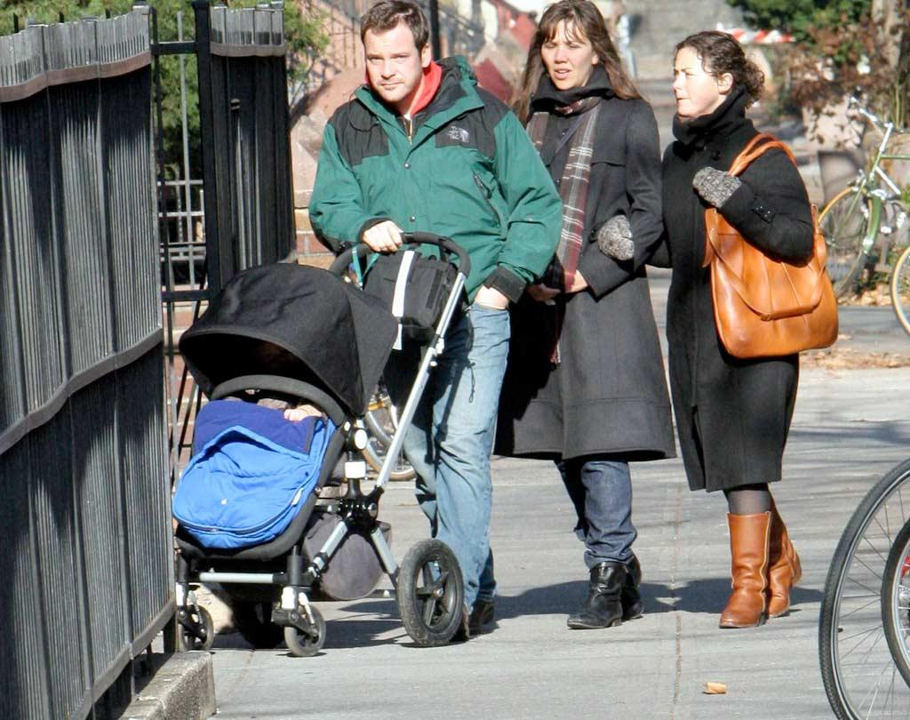 "Actress Maggie Gyllenhaal (""Sherrybaby,"" ""Secretary""), her husband Peter Sarsgaard (""Shattered Glass,"" ""Jarhead""), and a gal pal go for a stroll with baby Ramona on a chilly day in New York. JSB/<a href=""http://www.x17online.com"" target=""new"">X17 Online</a> - December 11, 2007"