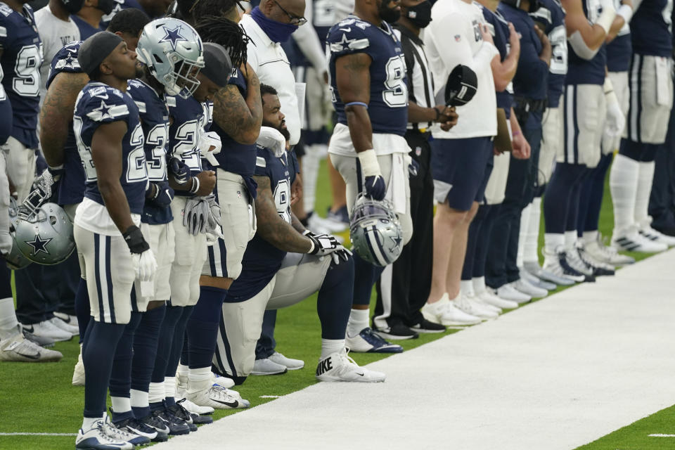 A member of the Dallas Cowboys kneels during the national anthem before an NFL football game against the Los Angeles Rams Sunday, Sept. 13, 2020, in Inglewood, Calif. (AP Photo/Ashley Landis)