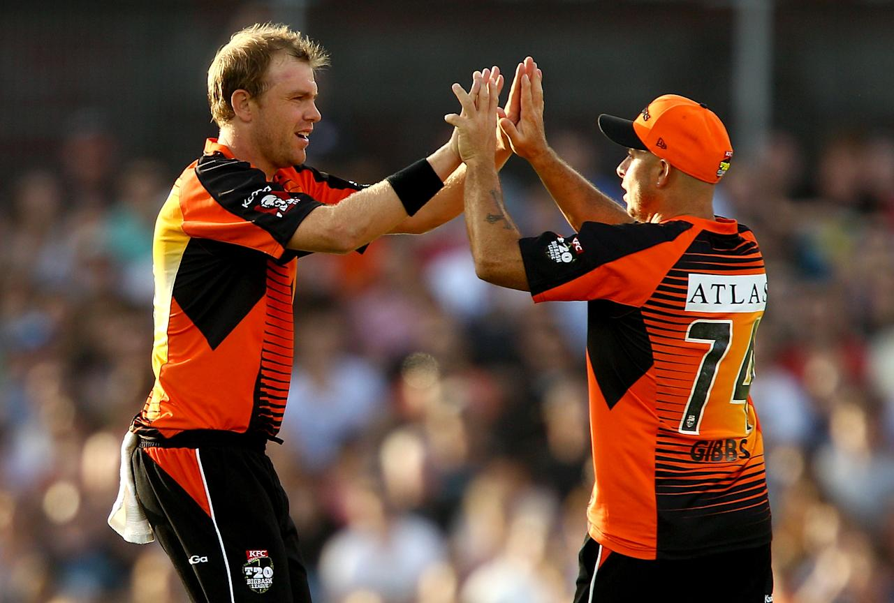 PERTH, AUSTRALIA - JANUARY 04: Michael Beer and Herschelle Gibbs of the Scorchers celebrate dismissing Simon Keen of the Thunder during the Big Bash League match between the Perth Scorchers and the Sydney Thunder at WACA on January 4, 2013 in Perth, Australia.  (Photo by Paul Kane/Getty Images)
