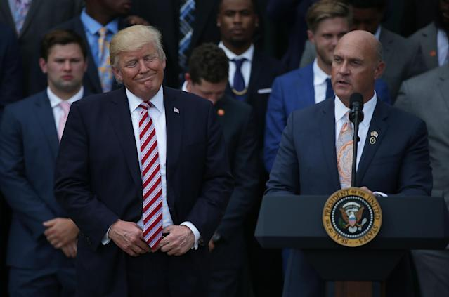 Clemson University President Jim Clements (R) speaks as President Donald Trump (L) listens when the Tigers visited after winning the national title in 2017 (Getty Images)