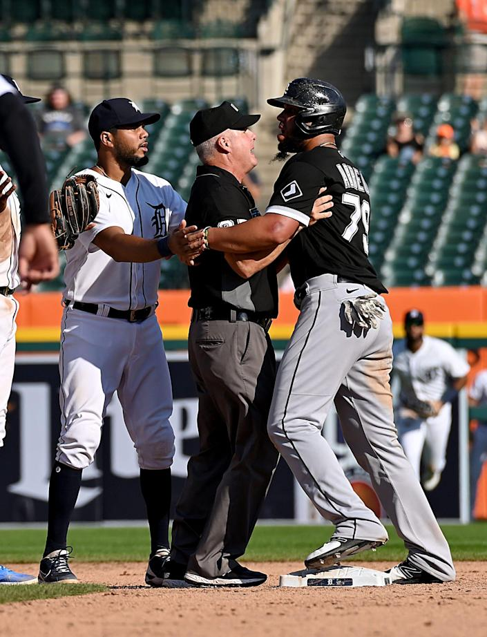 Players close-in on second base after Tigers shortstop Niko Goodrum tagged White Sox baserunner Jose Abreu while stealing second base and causes a ninth-inning bench-clearing scrum during the Tigers' 8-7 loss on Monday, Sept. 27, 2021, at Comerica Park.