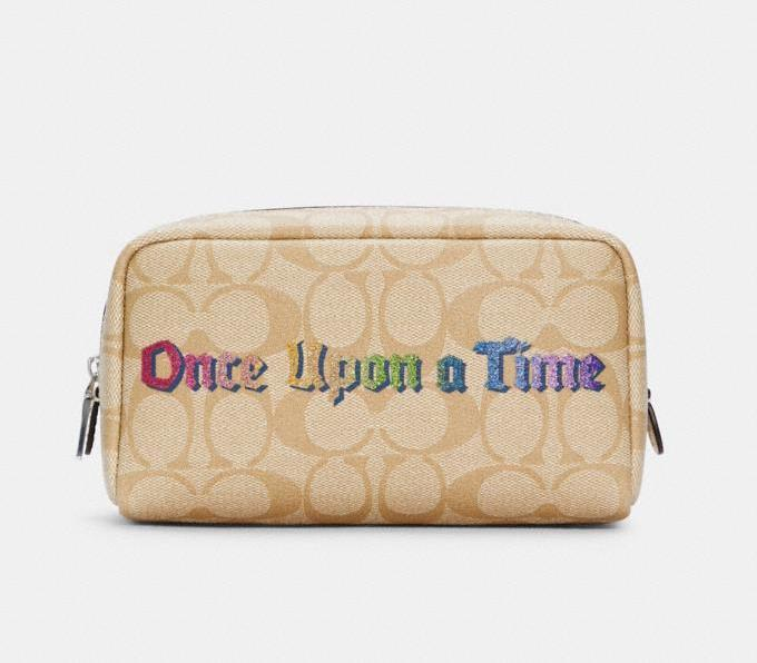 Disney X Coach Small Boxy Cosmetic Case In Signature Canvas With Once Upon A Time. Image via Coach Outlet.