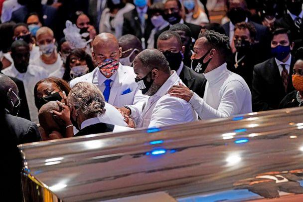 PHOTO: Philonise Floyd, brother, of George Floyd is comforted in front of the casket during the funeral on June 9, 2020, at The Fountain of Praise church in Houston. (David J. Phillip/Pool/AFP via Getty Images)