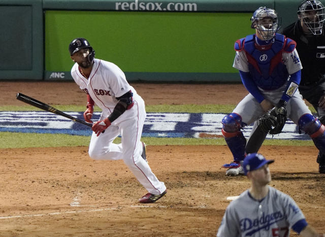 Boston Red Sox's Eduardo Nunez watches his three-run home run off Los Angeles Dodgers relief pitcher Alex Wood, front, during the seventh inning of Game 1 of the World Series baseball game Tuesday, Oct. 23, 2018, in Boston. (AP Photo/Elise Amendola)
