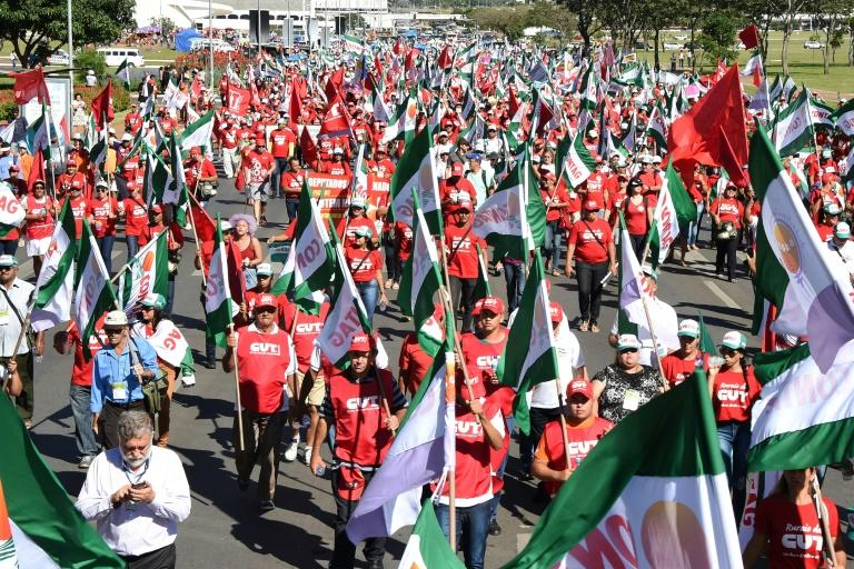 Members of Brazilian social movements march in Brasilia during a national strike against a government's Brazilian Social Welfare reform project on March 15, 2017
