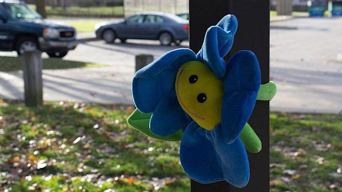 A solitary toy is left in a park as a memorial for Tamir Rice