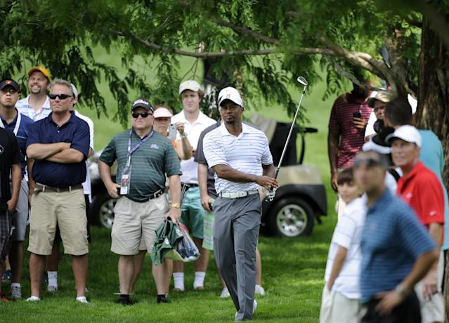 Tiger Woods watches his shot from the rough on the sixth hole during the Pro-Am at the Quicken Loans National golf tournament, Wednesday, June 25, 2014, in Bethesda, Md. (AP Photo/Nick Wass)