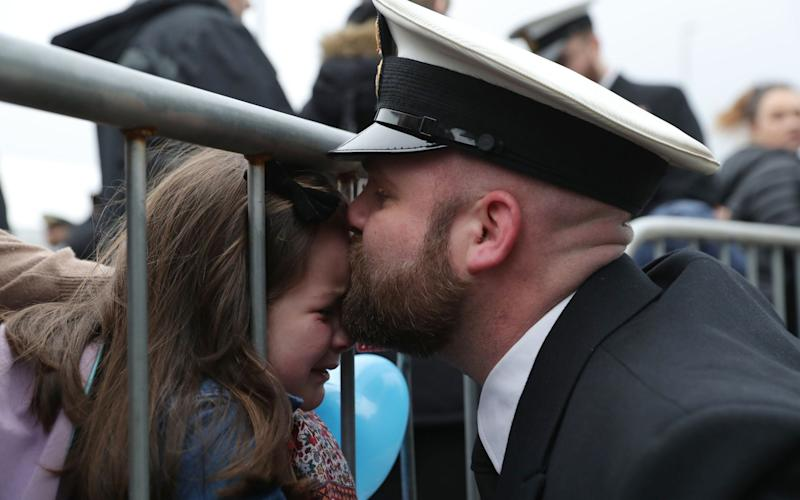 Petty Officer Adam Jeffrey (right) is greeted by his daughter Isabelle, 5 - Credit:  Andrew Matthews/PA