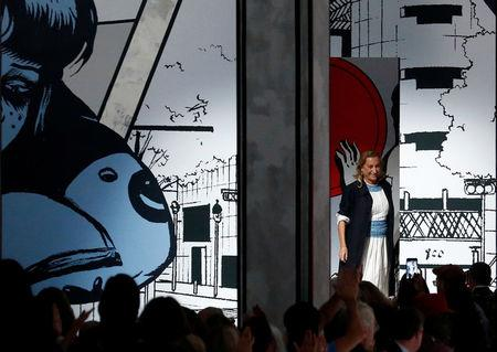 Italian designer Miuccia Prada acknowledges the applause at the end of her Spring/Summer 2018 show at the Milan Fashion Week in Milan