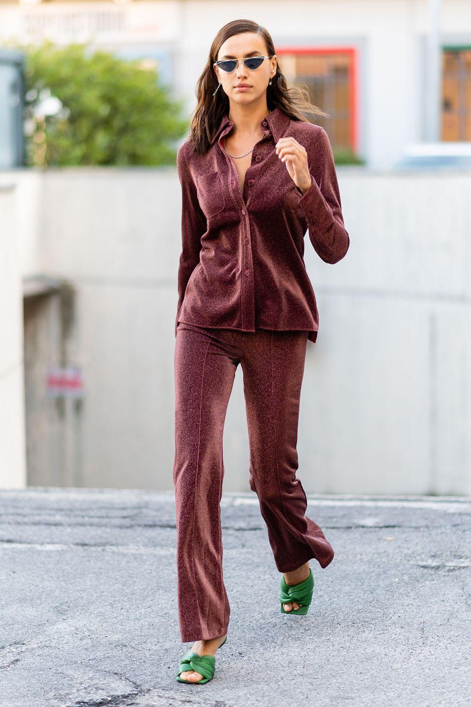 <p><strong>23 September </strong>The model was also seen in Milan in a chic two-piece with statement green mules. </p>